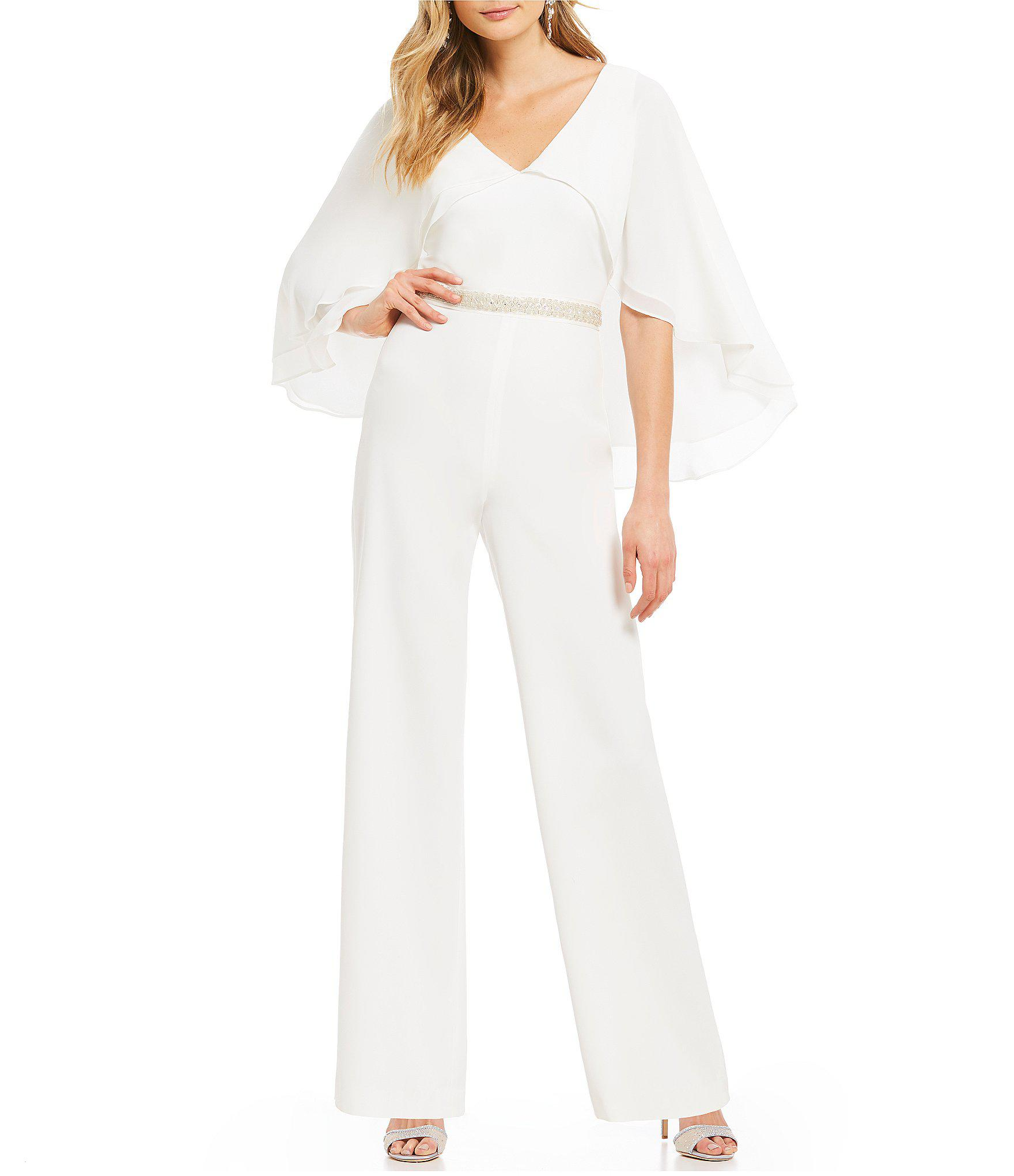 f489cf47959 Lyst - Belle By Badgley Mischka Cape Sleeve Jumpsuit in White
