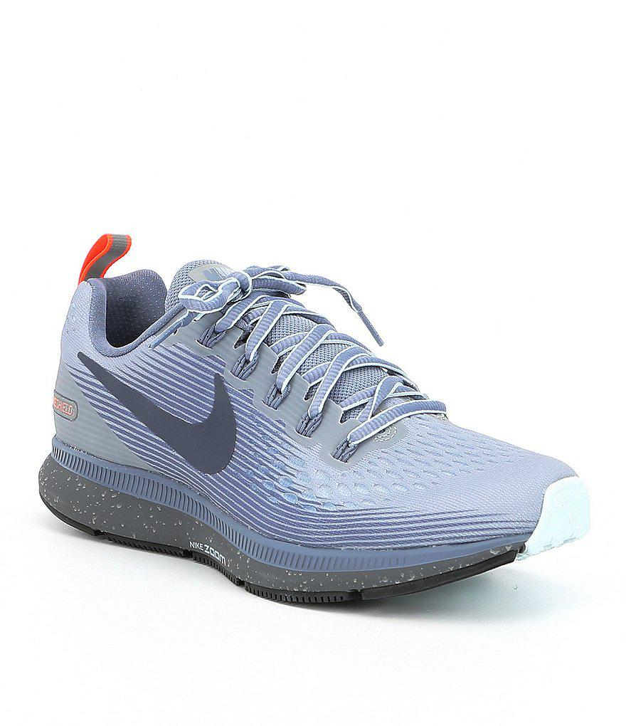 d3367443832 Lyst - Nike Women S Air Zoom Pegasus 34 Shield Running Shoes in Blue