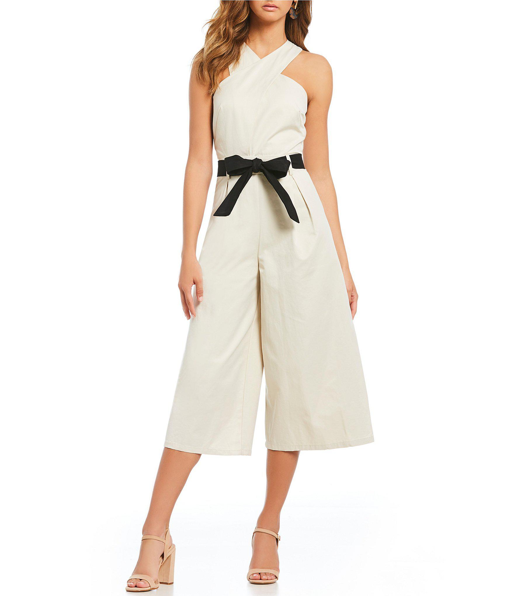 71b1e1d65e5 Lyst - Gianni Bini Cross Front Belted Culotte Jumpsuit in Natural