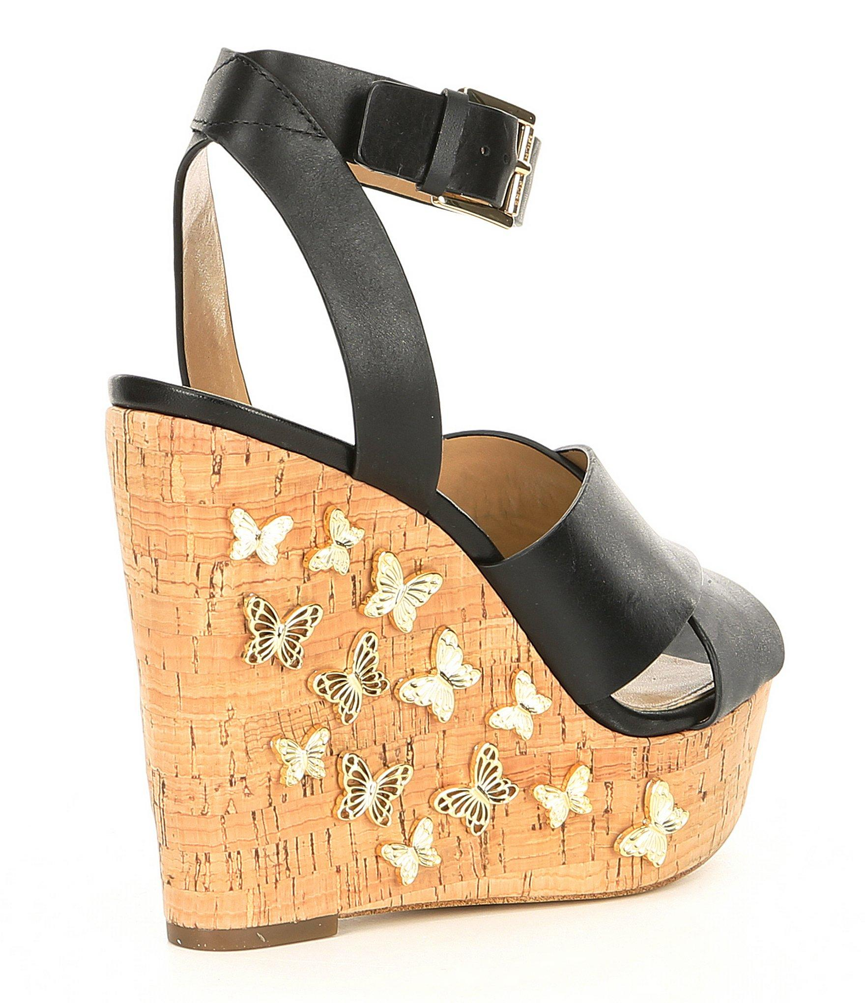 407cdc9b82e MICHAEL Michael Kors - Black Lacey Leather   Butterfly Charm Cork Wedge  Sandals - Lyst. View fullscreen