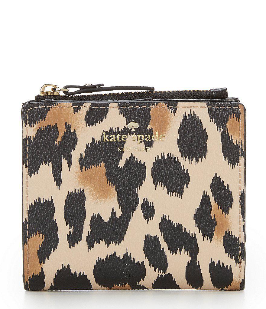 5a14e583a717 Kate Spade Hyde Lane Leopard Adalyn Bifold Wallet - Lyst