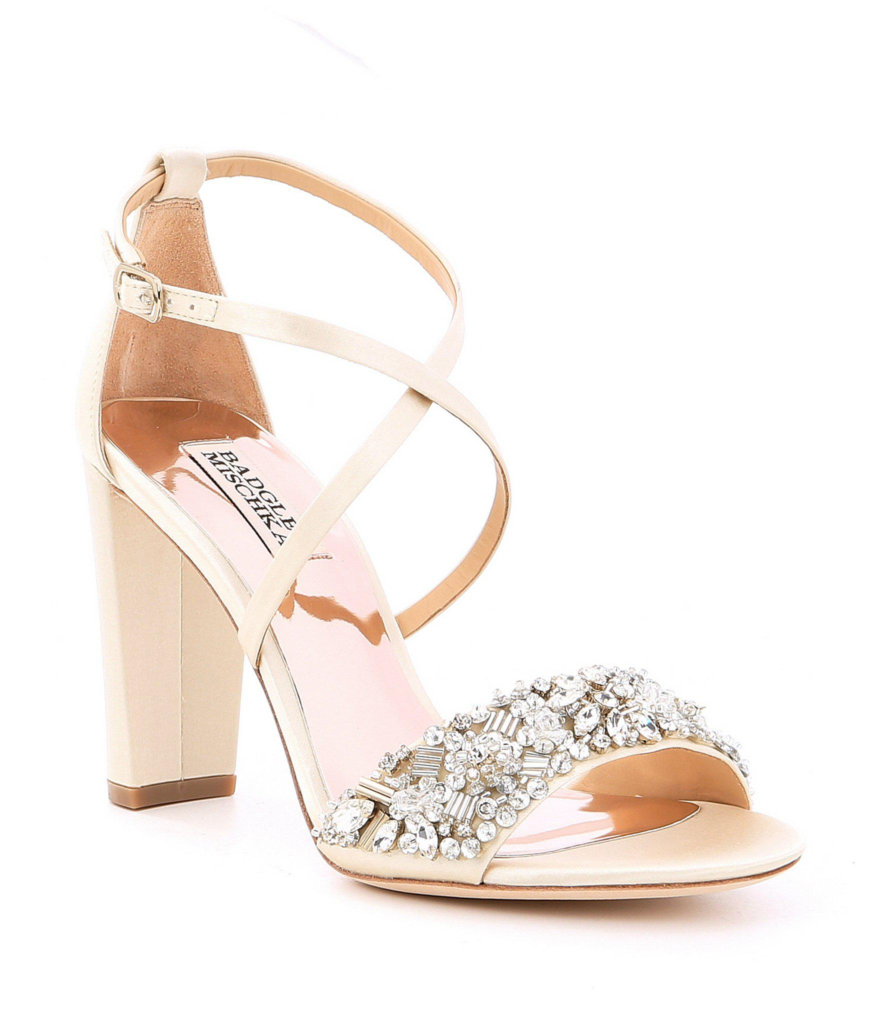 7d8cc7ffdd24 Badgley Mischka. Women s White Sandra Satin Jeweled Strappy Block Heel Dress  Sandals