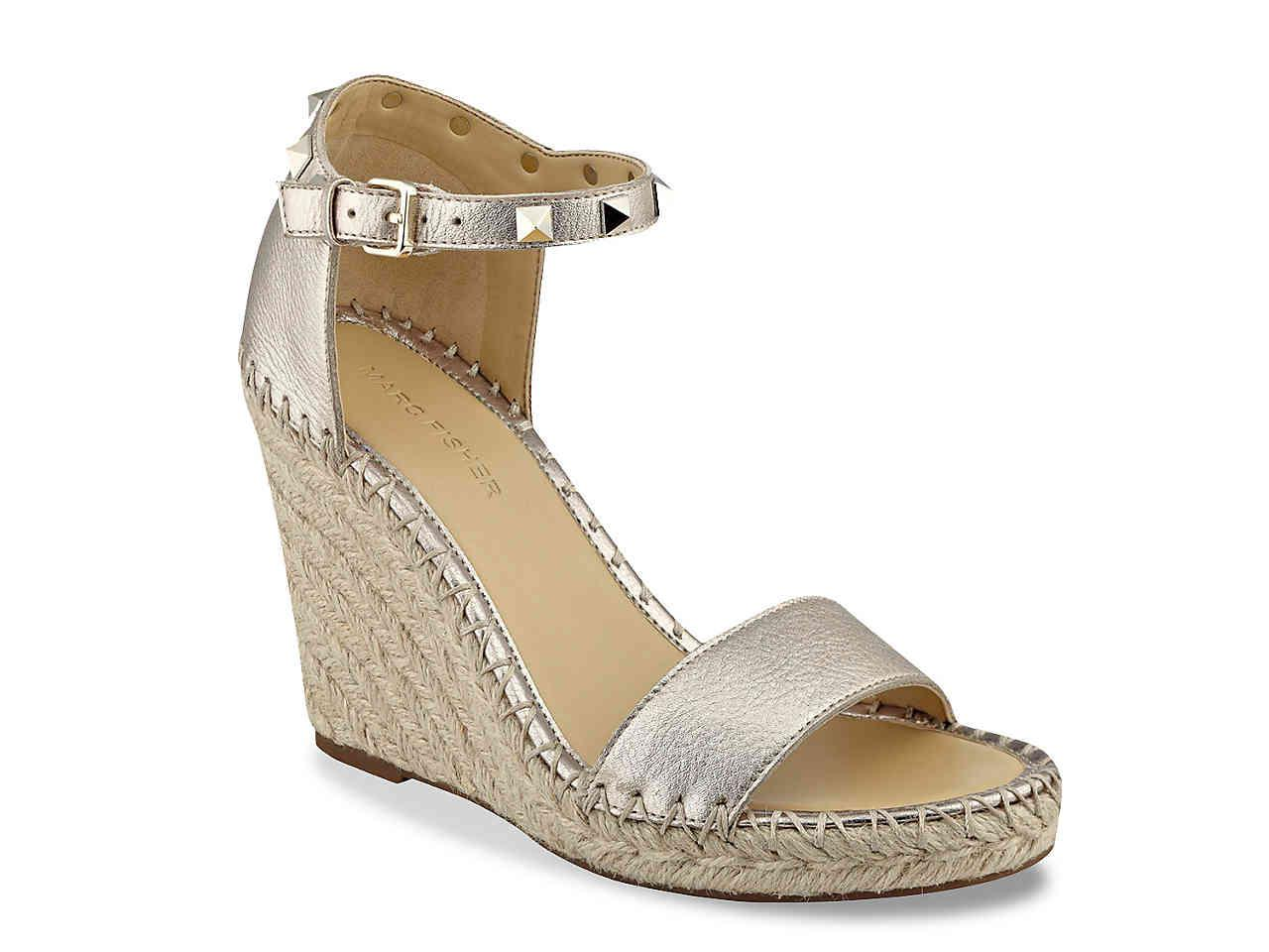 c48391ed404 Lyst - Marc Fisher Kicker Wedge Sandal in Metallic - Save 36%