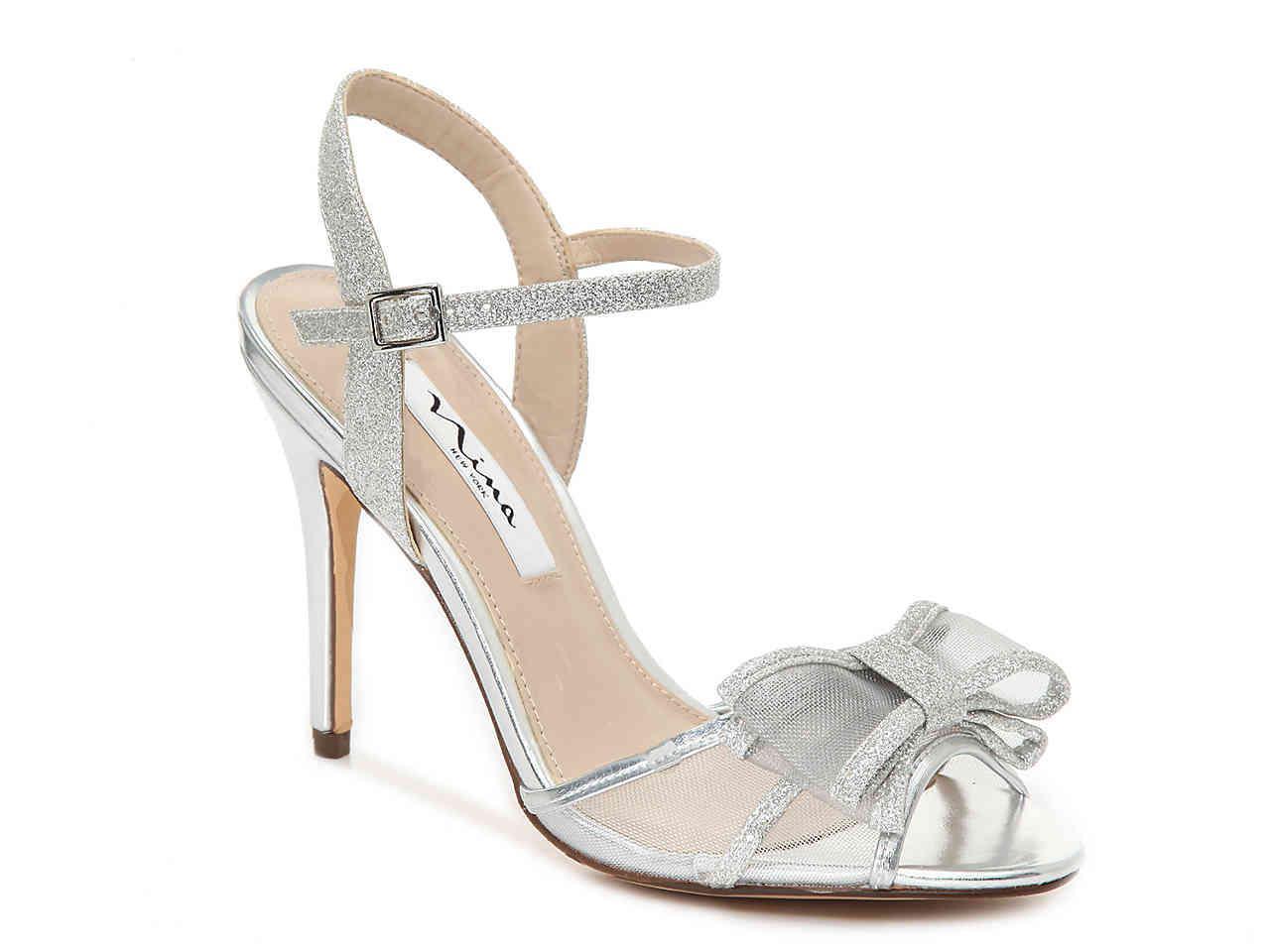 7edf35a9ea8e Lyst - Nina Charm Sandal in Metallic