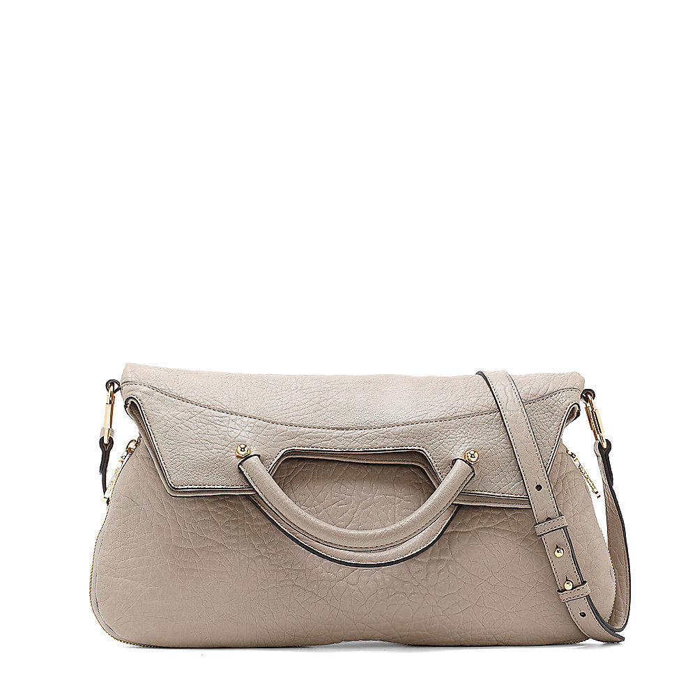 97f8b6ae32 Lyst - Vince Camuto Dulce - Foldable Leather Cross Body in Natural