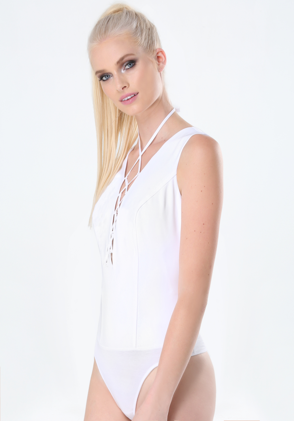 0b726ca1d1b294 Bebe Lace Up Sleeveless Bodysuit in White - Lyst