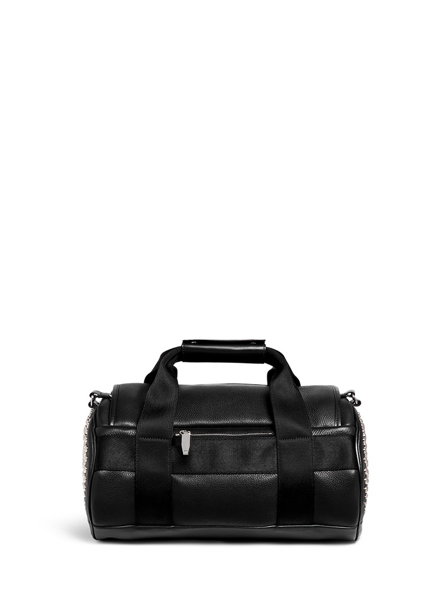 Lyst - Alexander Wang Stud Small Leather Duffle Bag in Black 6651fcec4ffe5