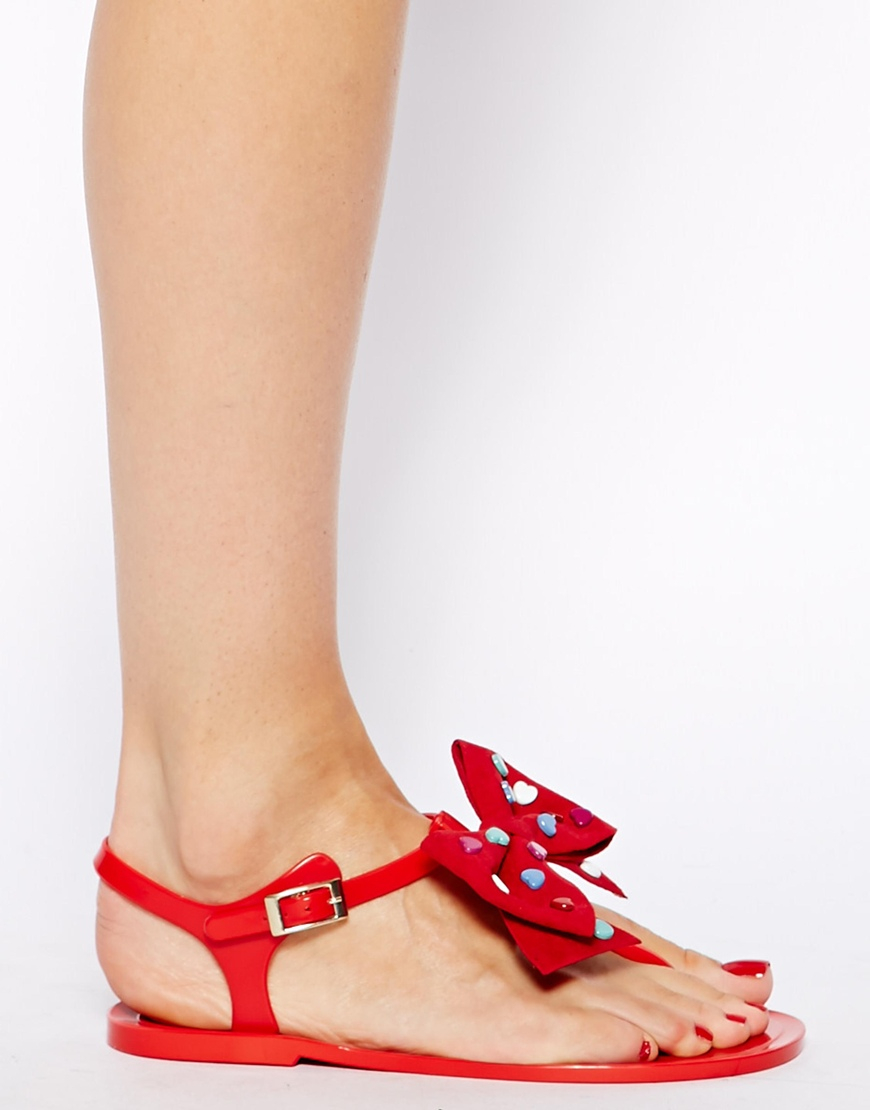 Love moschino heart bow red jelly flat sandals in red lyst