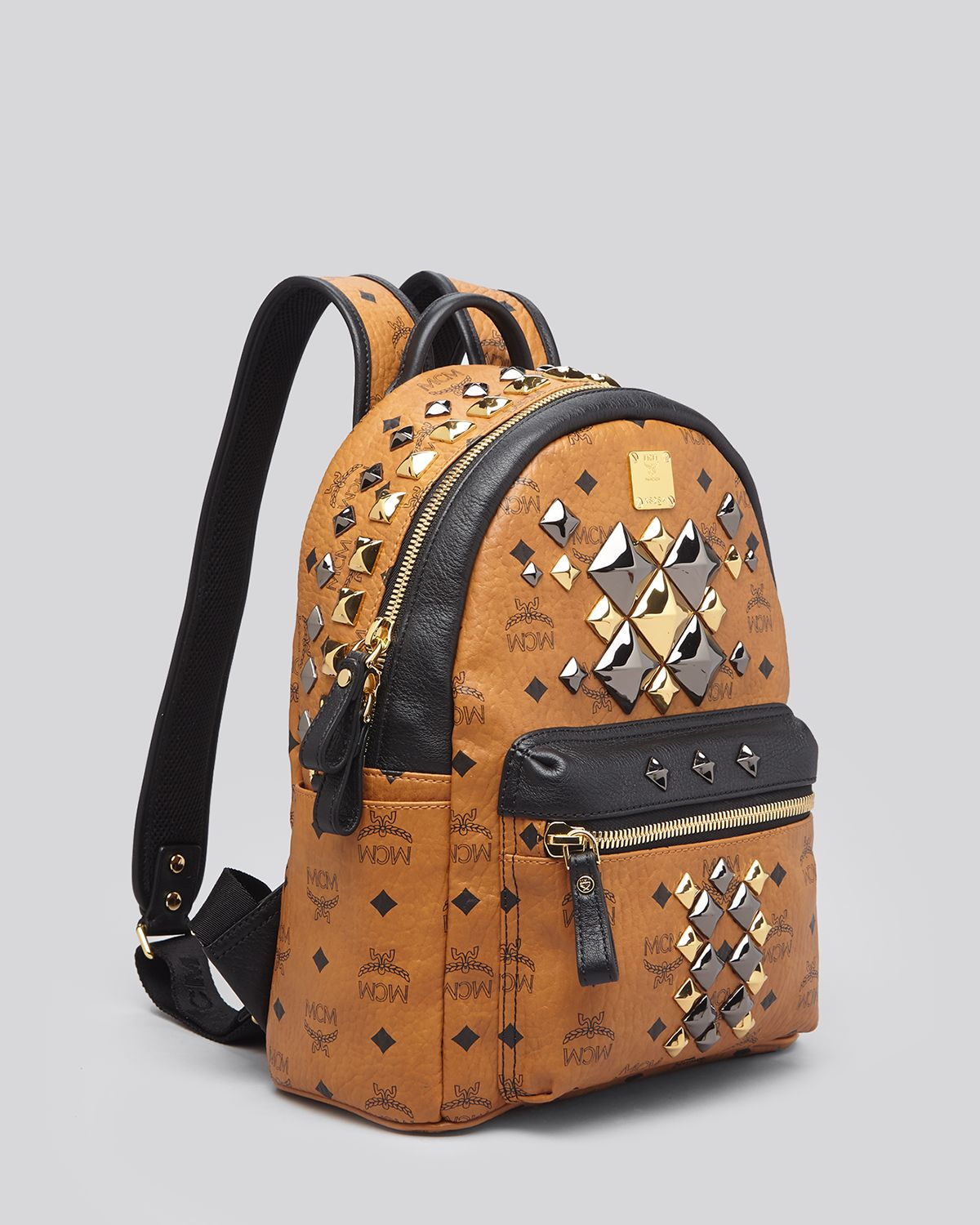 mcm backpack small stark brock colorblock studded in brown lyst. Black Bedroom Furniture Sets. Home Design Ideas