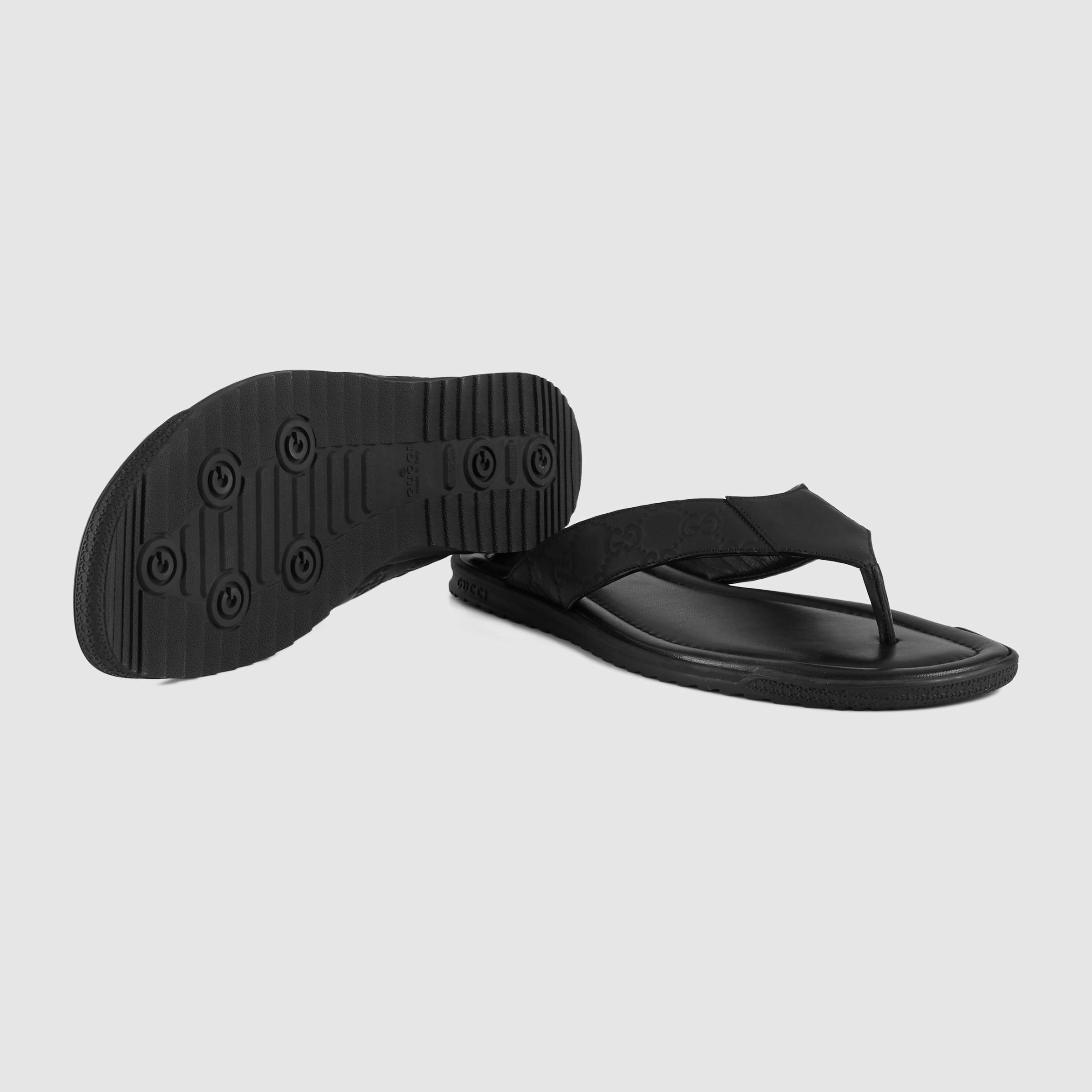 67337587b99a Lyst - Gucci Rubberized Leather Thong Sandal in Black for Men