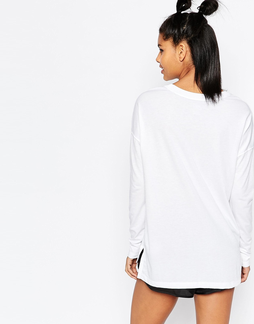 308ca262fb Nike Small Logo Long Sleeve Signal Top - White in White - Lyst