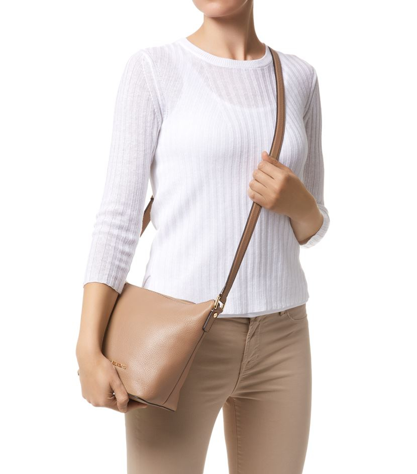 8433816ee823 ... purchase michael michael kors small bedford messenger bag in natural  lyst 22814 9cde6