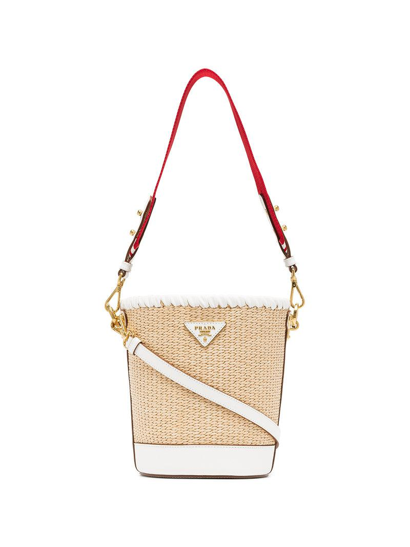 3a9c83d2b0ec ... coupon code lyst prada white nude and red logo raffia bucket bag in  natural ceaa2 25117