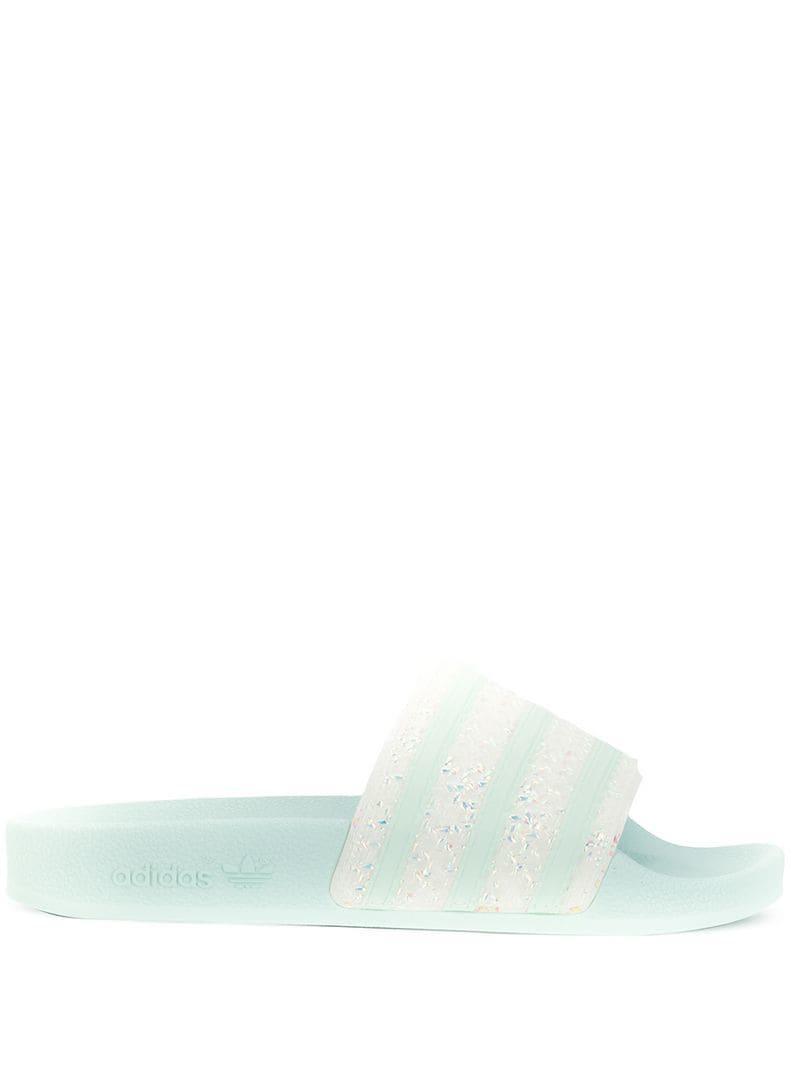 5cd24cced adidas Adilette Sliders in Blue - Lyst