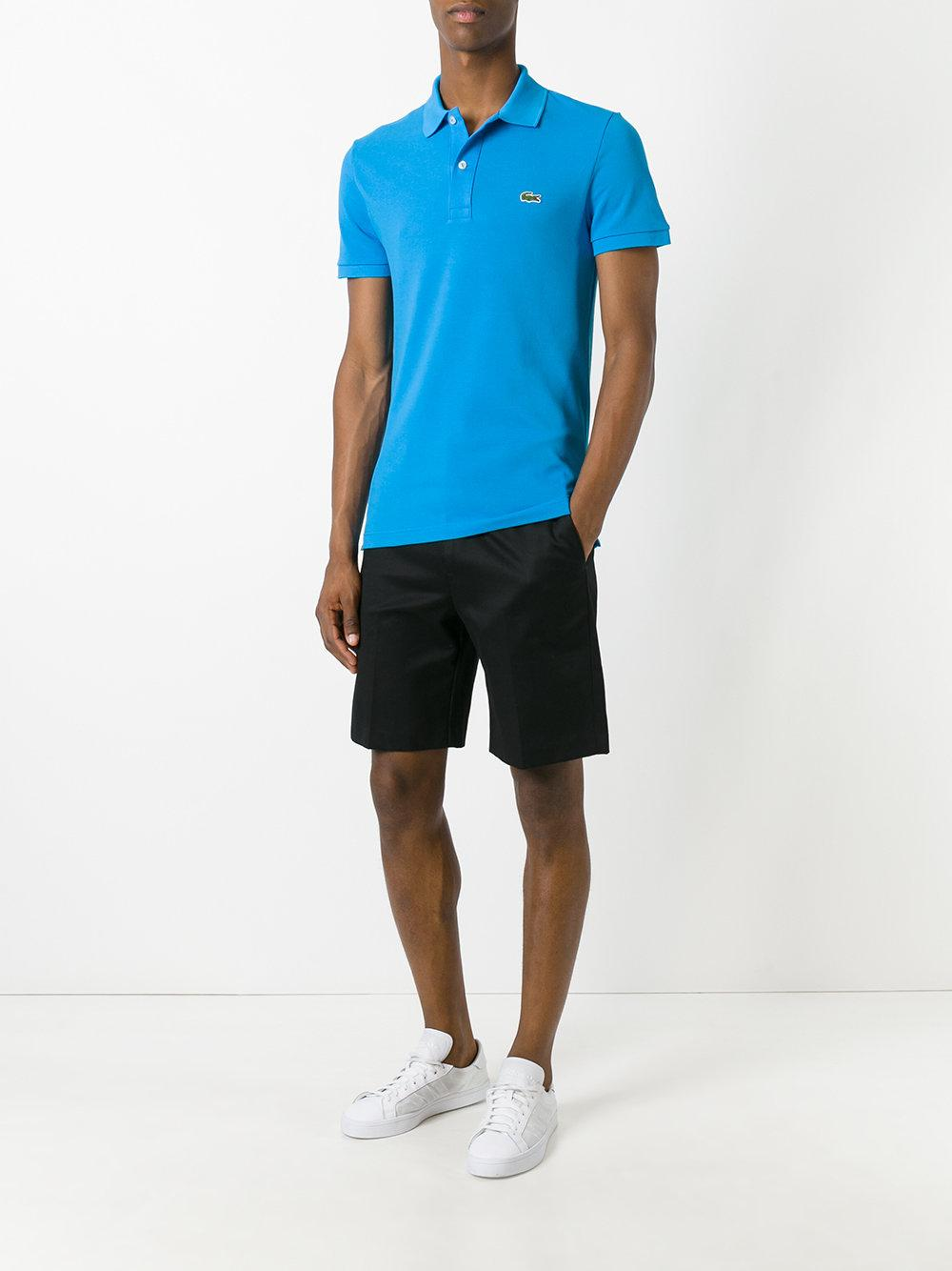 Lyst lacoste logo patch polo shirt in blue for men for Lacoste size 4 polo shirt