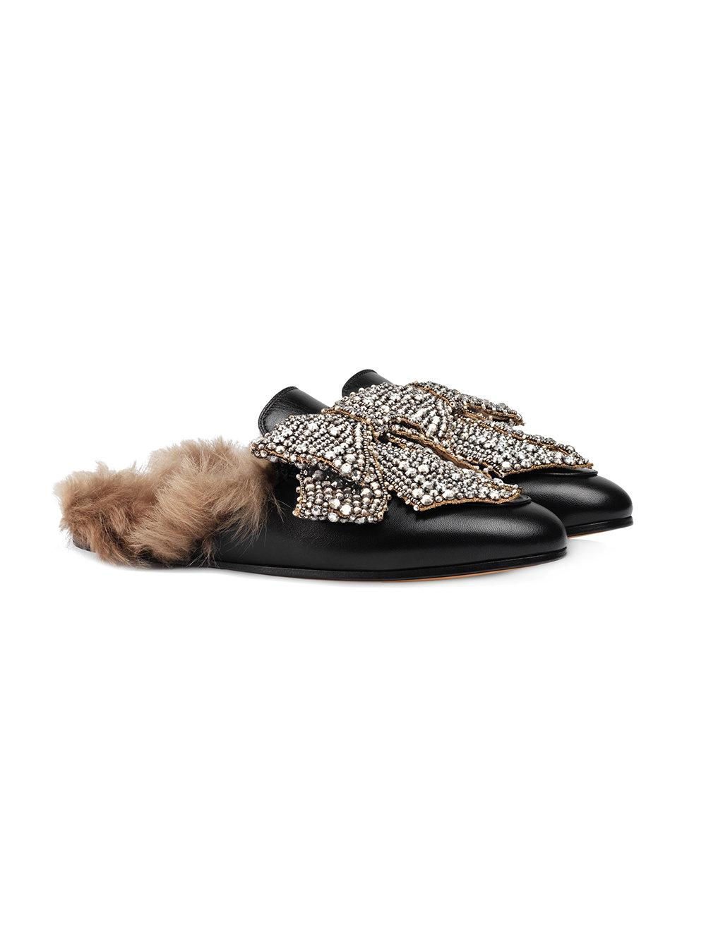 a36f1729077 Lyst - Gucci Crystal Bow Princetown Leather Mules in Black - Save 53%