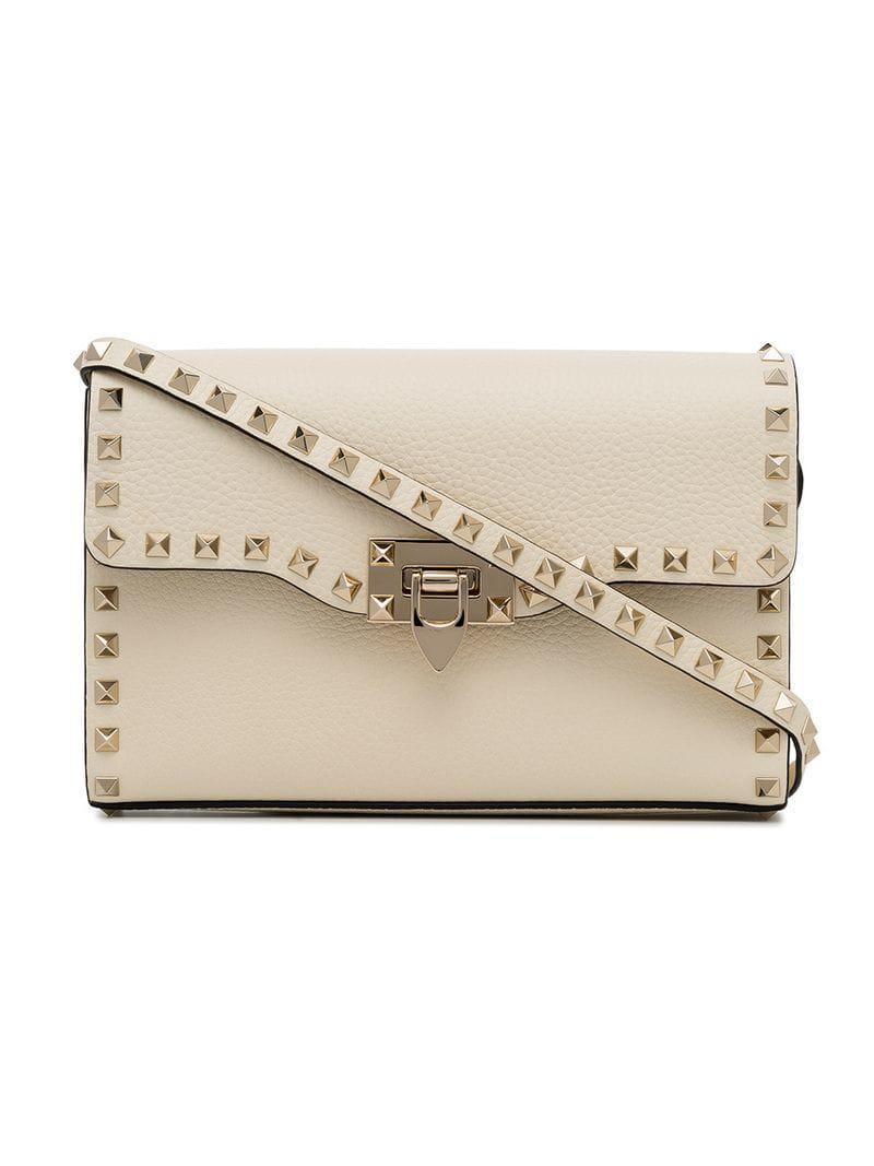 881f21e02670 Valentino Off-white Rockstud Leather Crossbody Bag in White - Save 1 ...