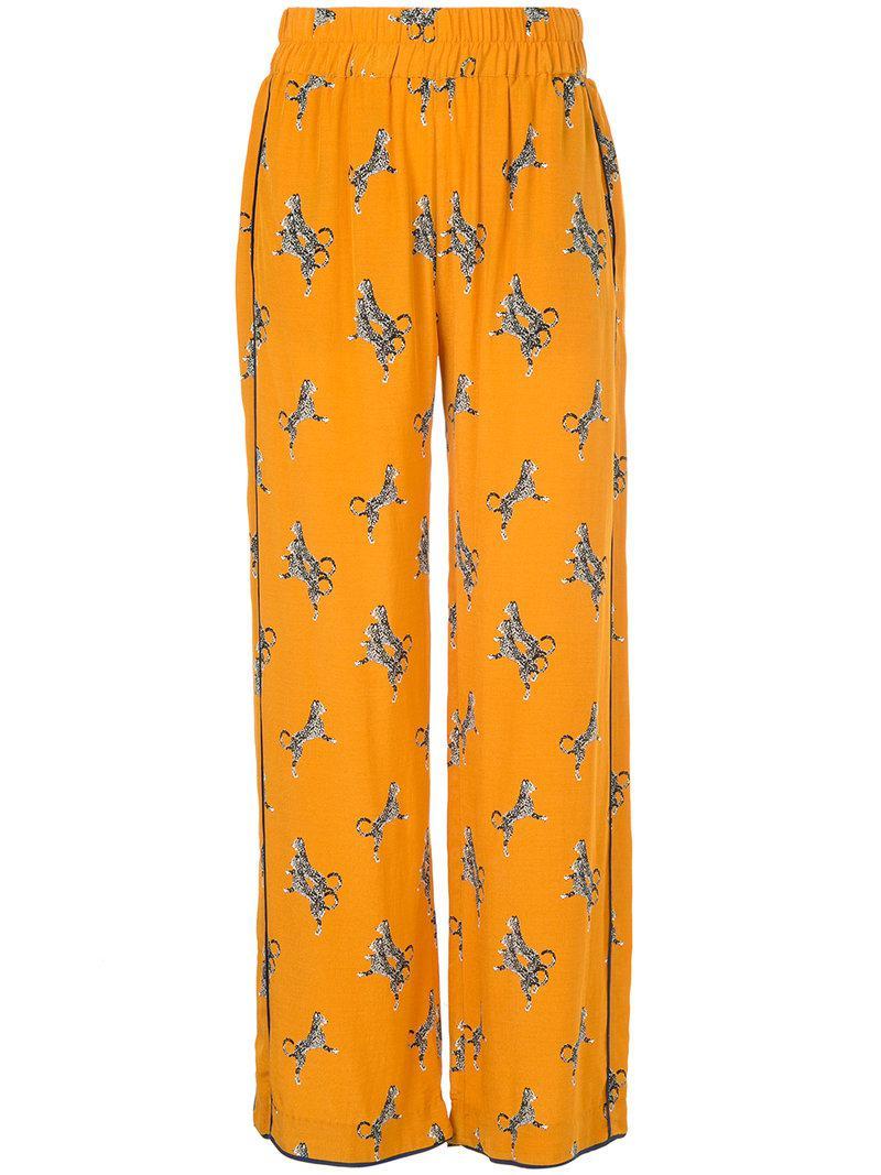 99d07e50d9c3 Baum und Pferdgarten Cheetah Print Straight Leg Trousers in Orange ...