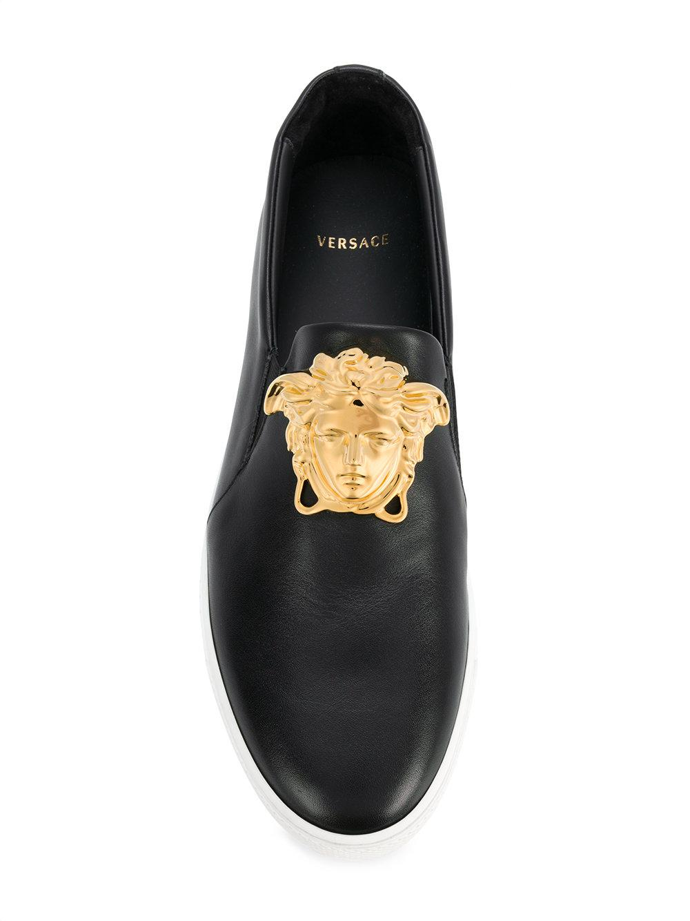f4379b0f VERSACE Black Medusa Patent Leather Sneakers 725 These black