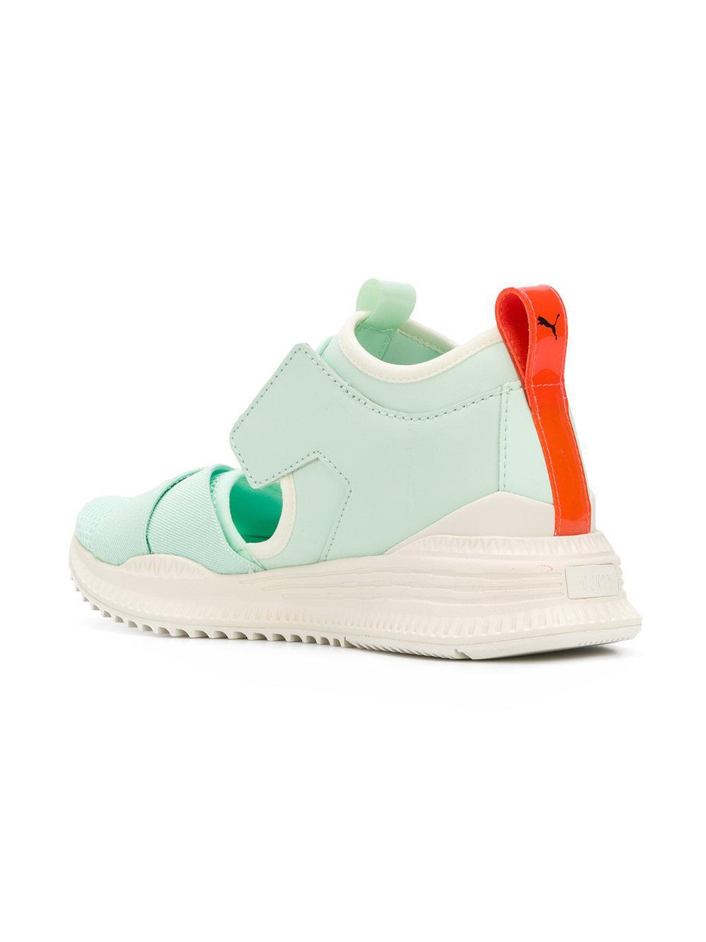 Lyst - PUMA Fenty Cutout Sneakers in Green 00a4a3b71