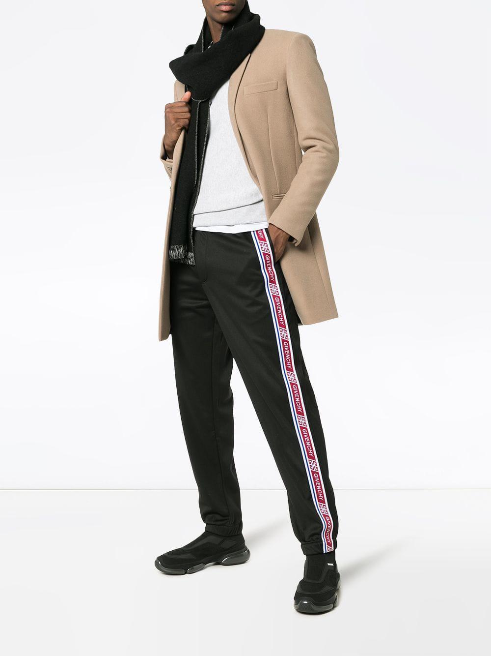 5e74ee0715e Lyst - Pantalon de jogging à bandes logo Givenchy pour homme en coloris Noir