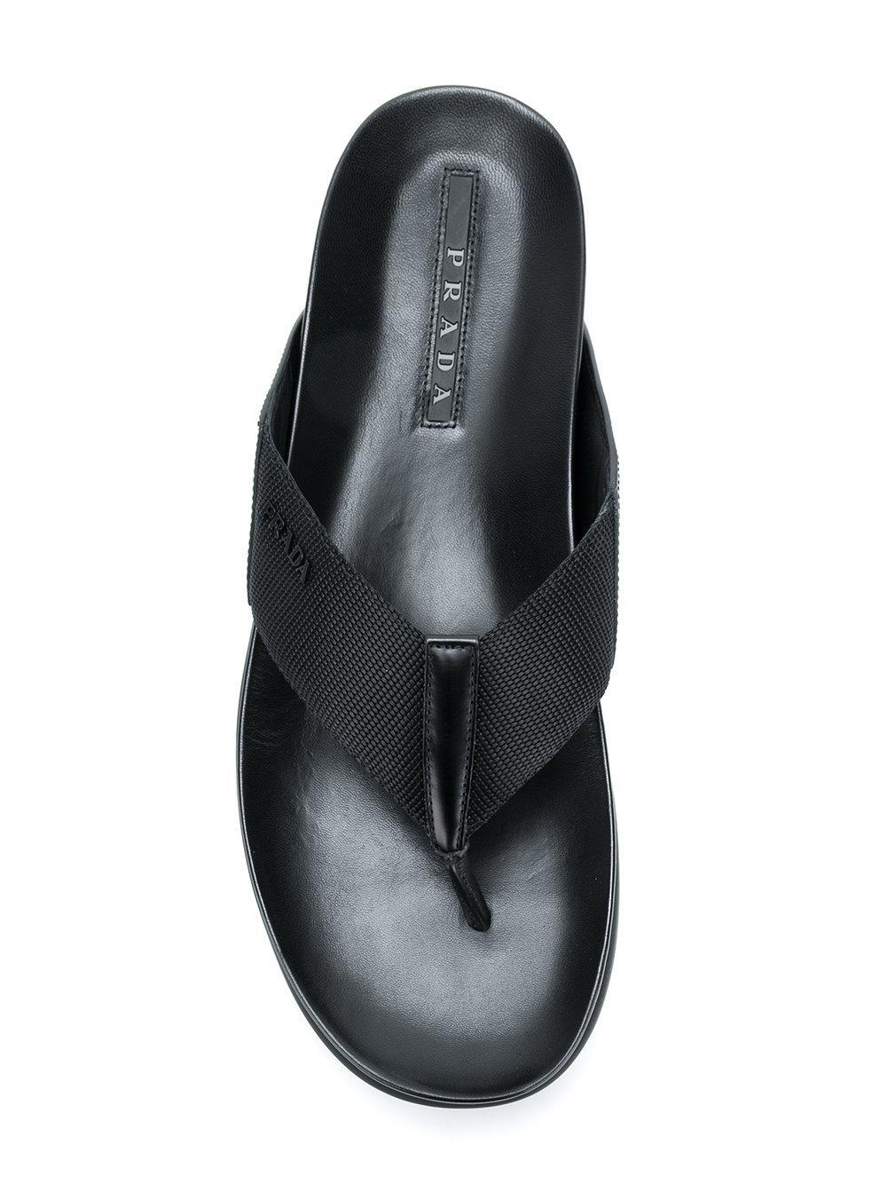 c770d792de6f8f Prada - Black Metal Logo Flip Flops for Men - Lyst. View fullscreen
