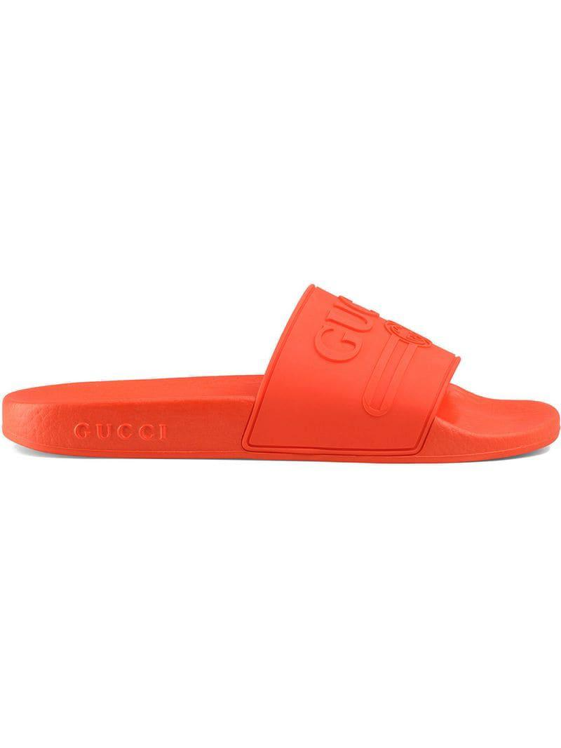 9c191bb5bc9 Gucci - Yellow Logo Rubber Slide Sandals - Lyst. View fullscreen