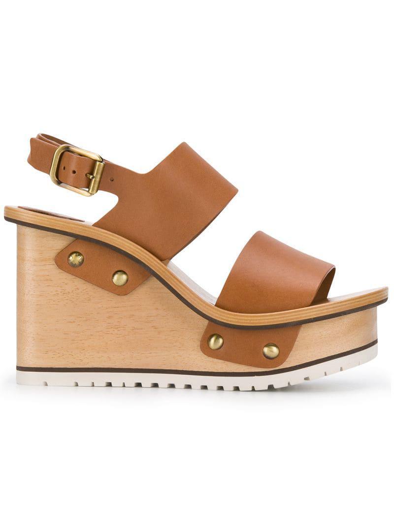 c733ea7cb57c Chloé. Women s Brown Buckle Wedge Sandals