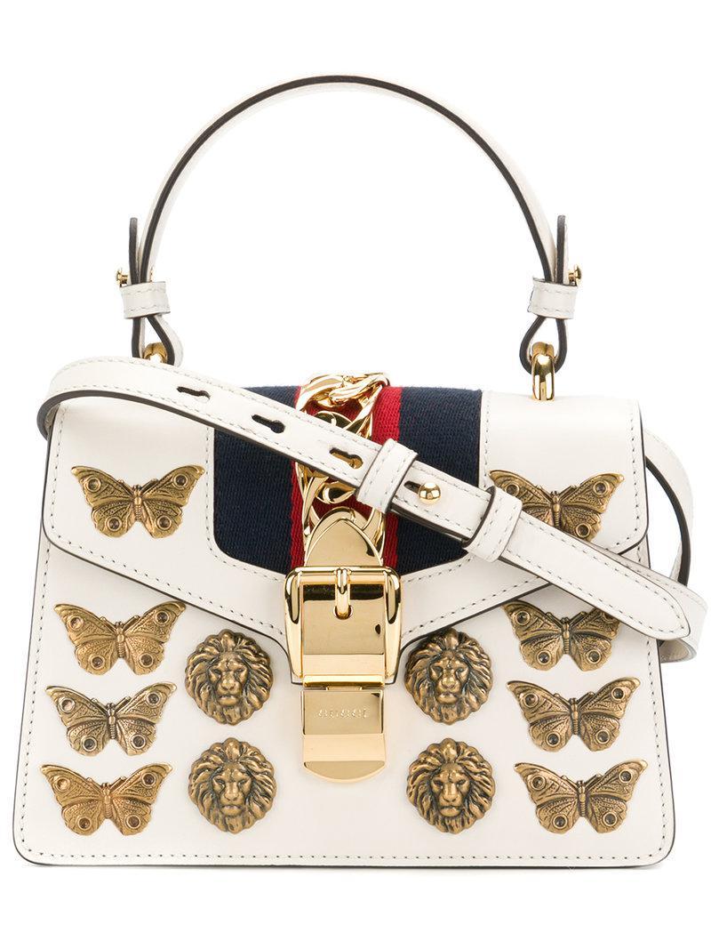 1fe6b13e7a9d Gucci Sylvie Gold Bug Bag in White - Lyst