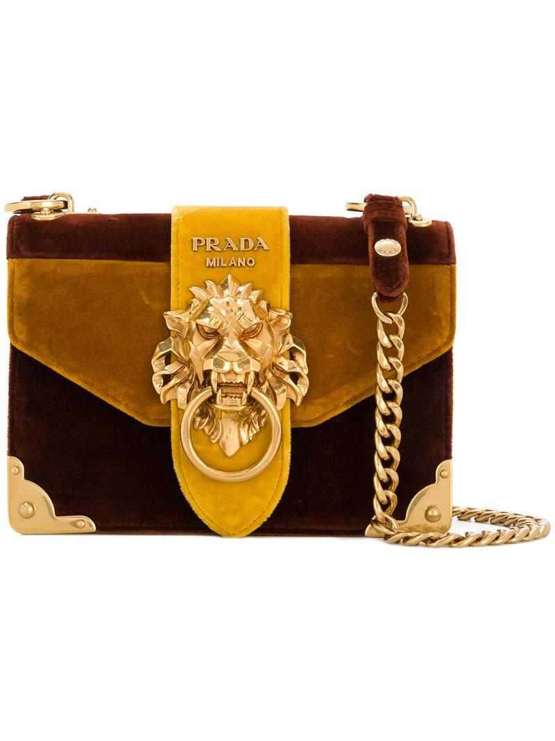 ... closeout lyst prada cahier lion embellished shoulder bag in brown de972  159e6 f730c96941a6b