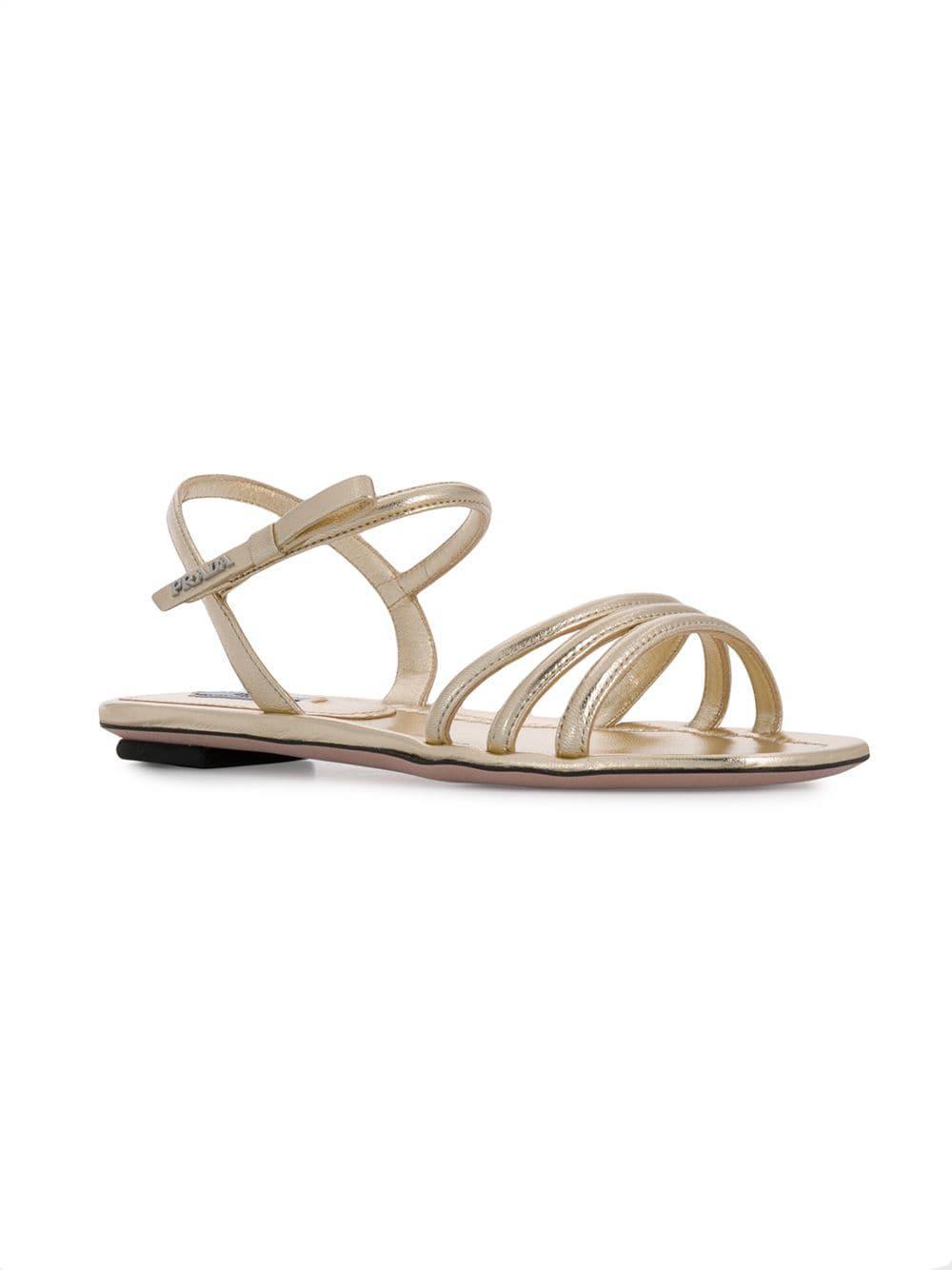 8c33f8a037b Prada - Metallic Flat Strappy Sandals - Lyst. View fullscreen