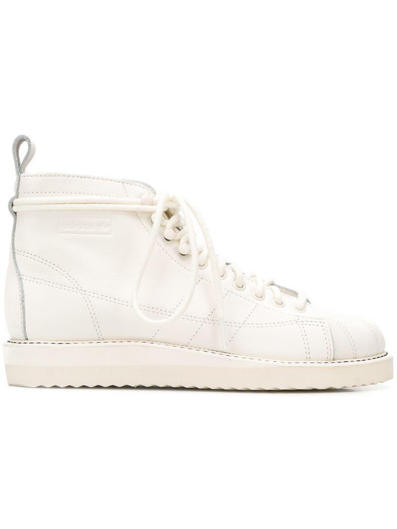 55d0486434ca Lyst - adidas Superstar Boots in White