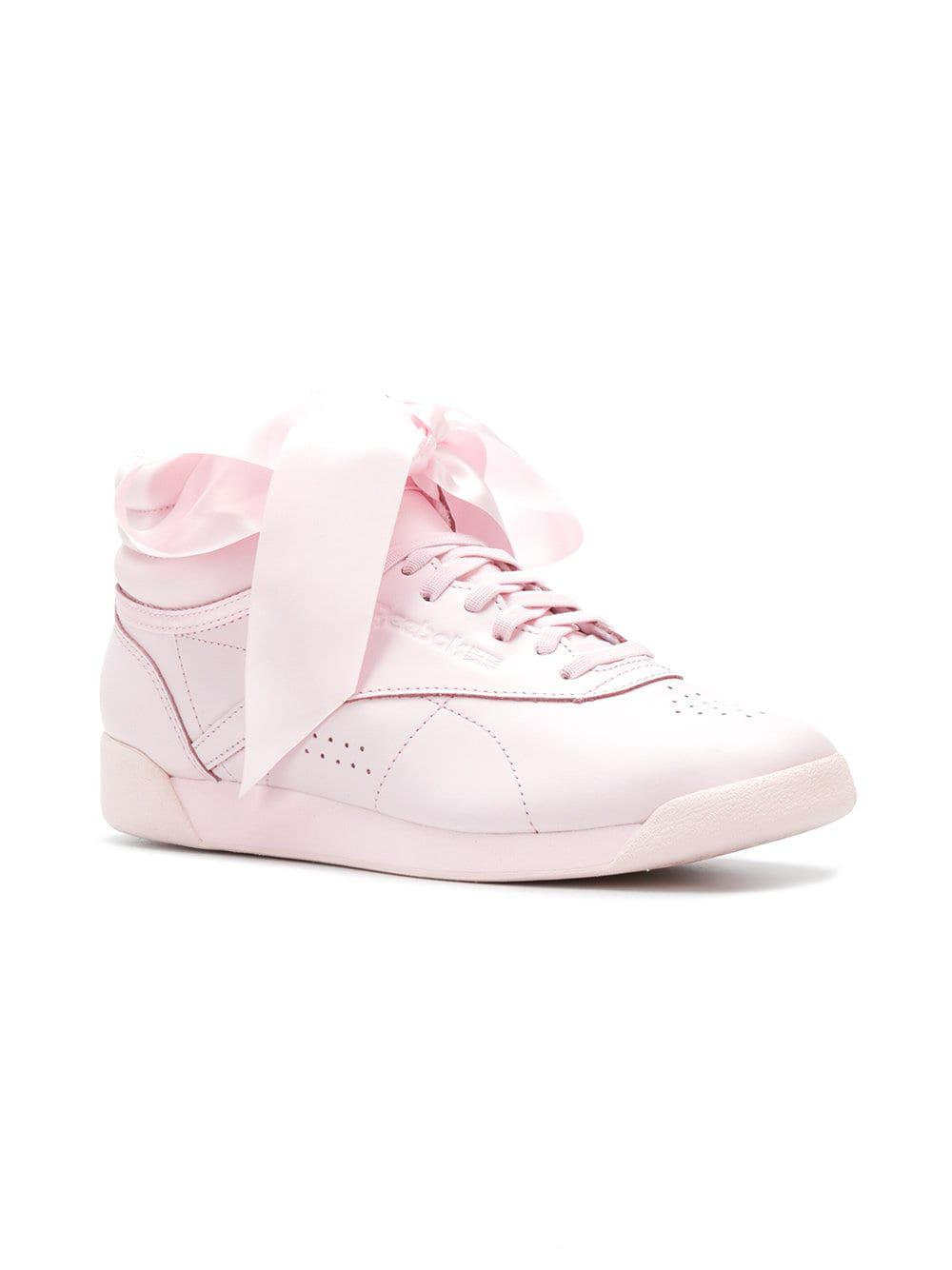 19d288fb2d96 Reebok - Pink Freestyle Hi Satin Bow Sneakers - Lyst. View fullscreen