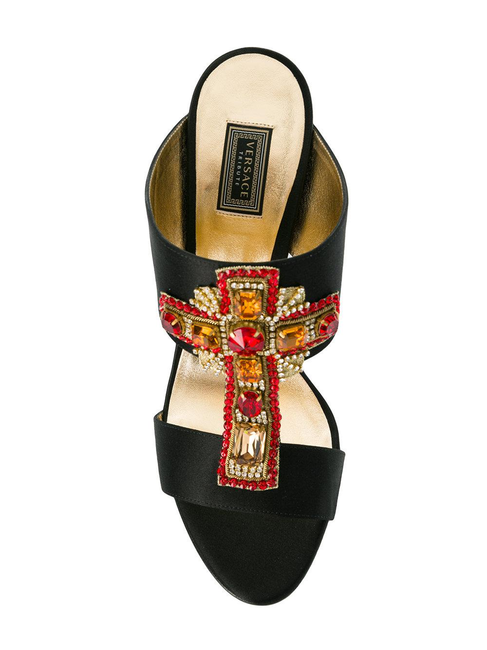 f7991e928cefd6 Lyst - Versace Embellished Cross Mules in Black