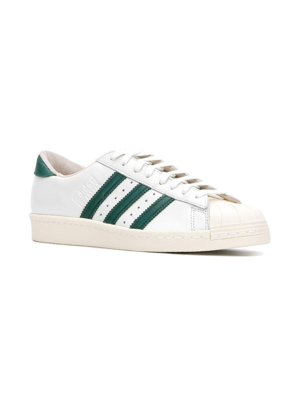 low priced d57d8 02b46 Lyst - adidas Superstar Low Top Trainers in White for Men