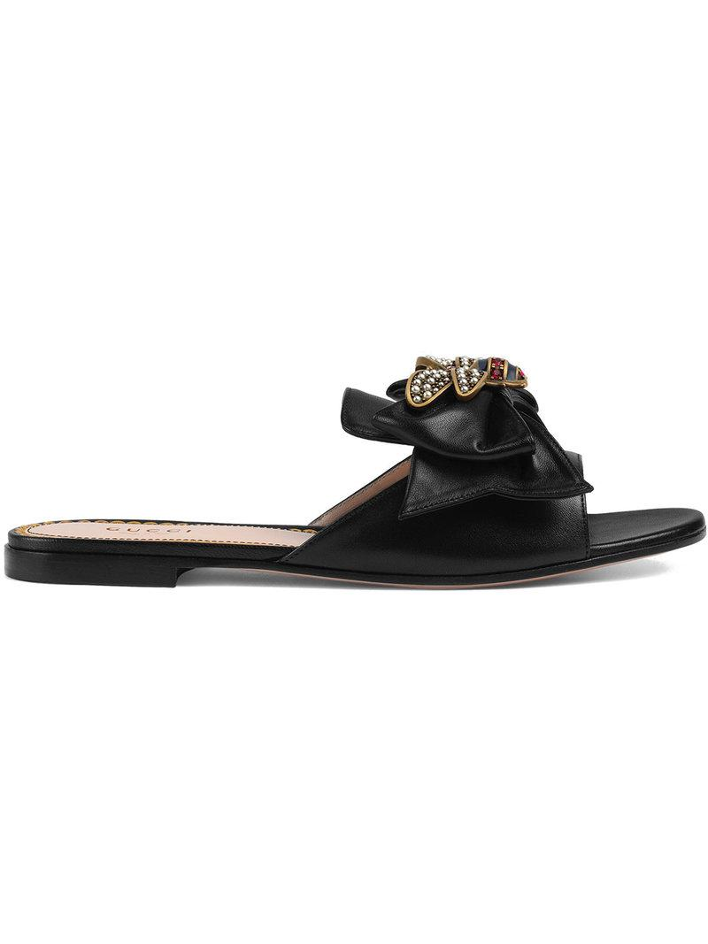 1c5314ea58c Lyst - Gucci Leather Slides With Bow in Black