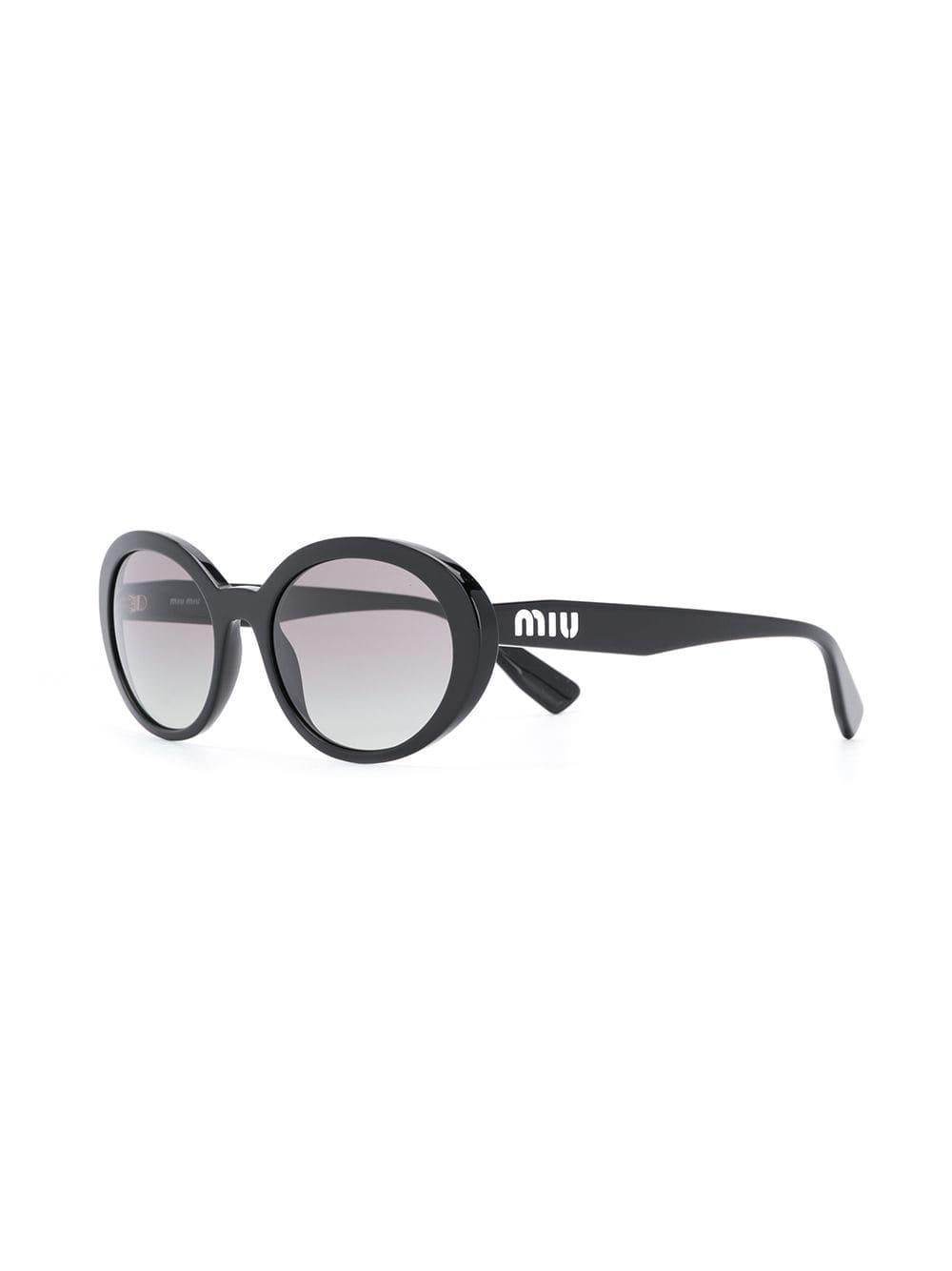 8d6e03d2eb4 Miu Miu - Black Round Frame Sunglasses - Lyst. View fullscreen