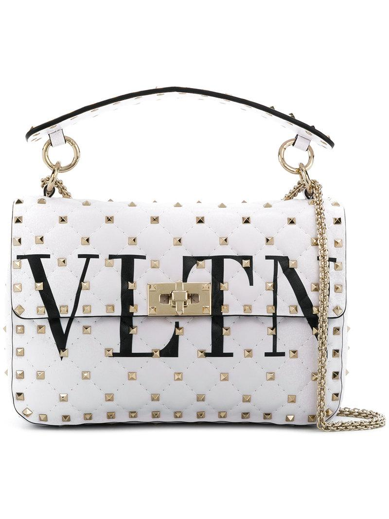 55d7d69fd979 Lyst - Valentino Rockstud Spike Medium Bag in White - Save 3%