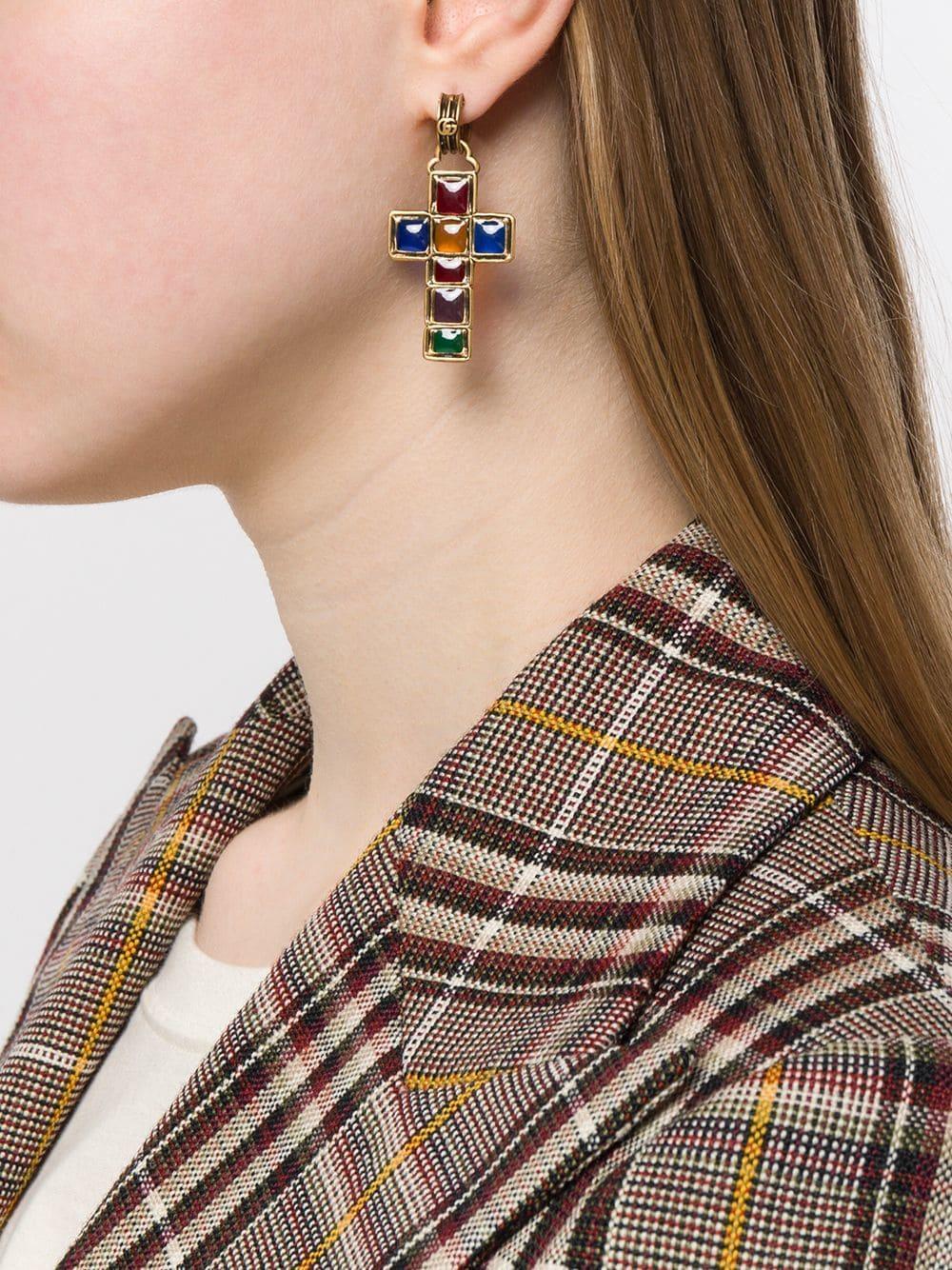 fd4e67d1001 Lyst - Gucci Asymmetric Cross Earrings in Metallic