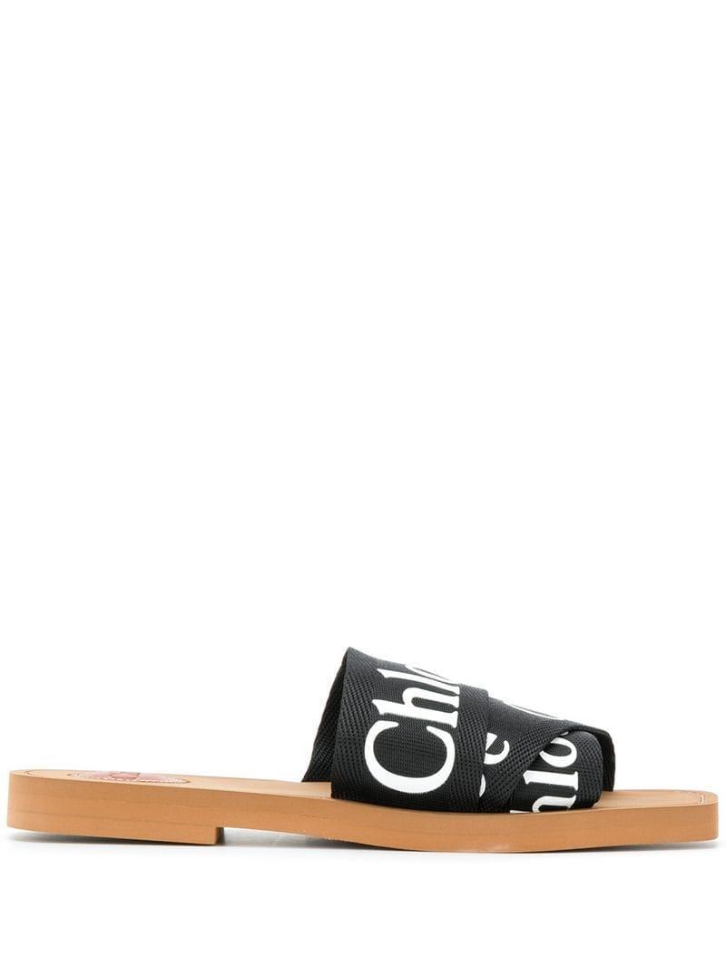 7e5ffea106dd66 Lyst - Chloé Woody Logo Print Slides in Black - Save 19%