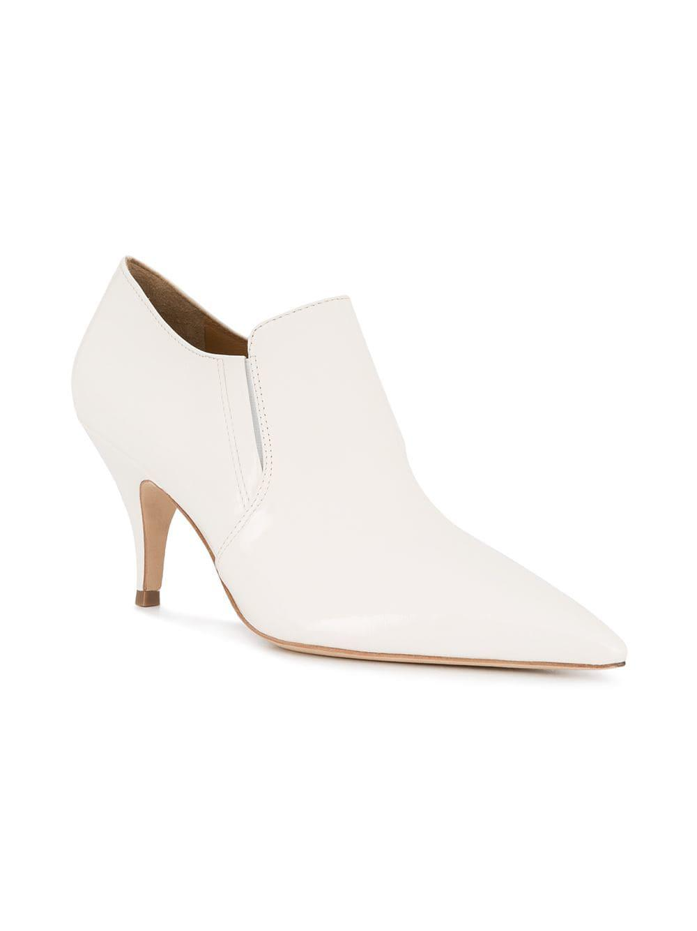cb3356a5fa56 Lyst - Tory Burch Women s Georgina Pointed Toe Leather High-heel Booties in  White - Save 52%