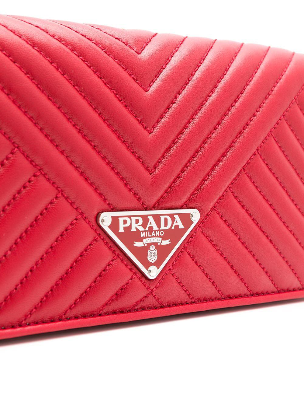 ce64895ee4e1 Prada Logo Plaque Quilted Clutch in Red - Lyst