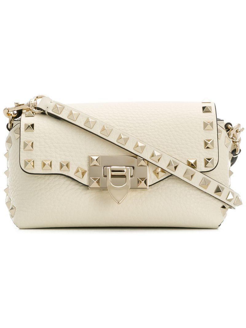 7029953cd94c Valentino Garavani Rockstud Crossbody Bag in White - Lyst