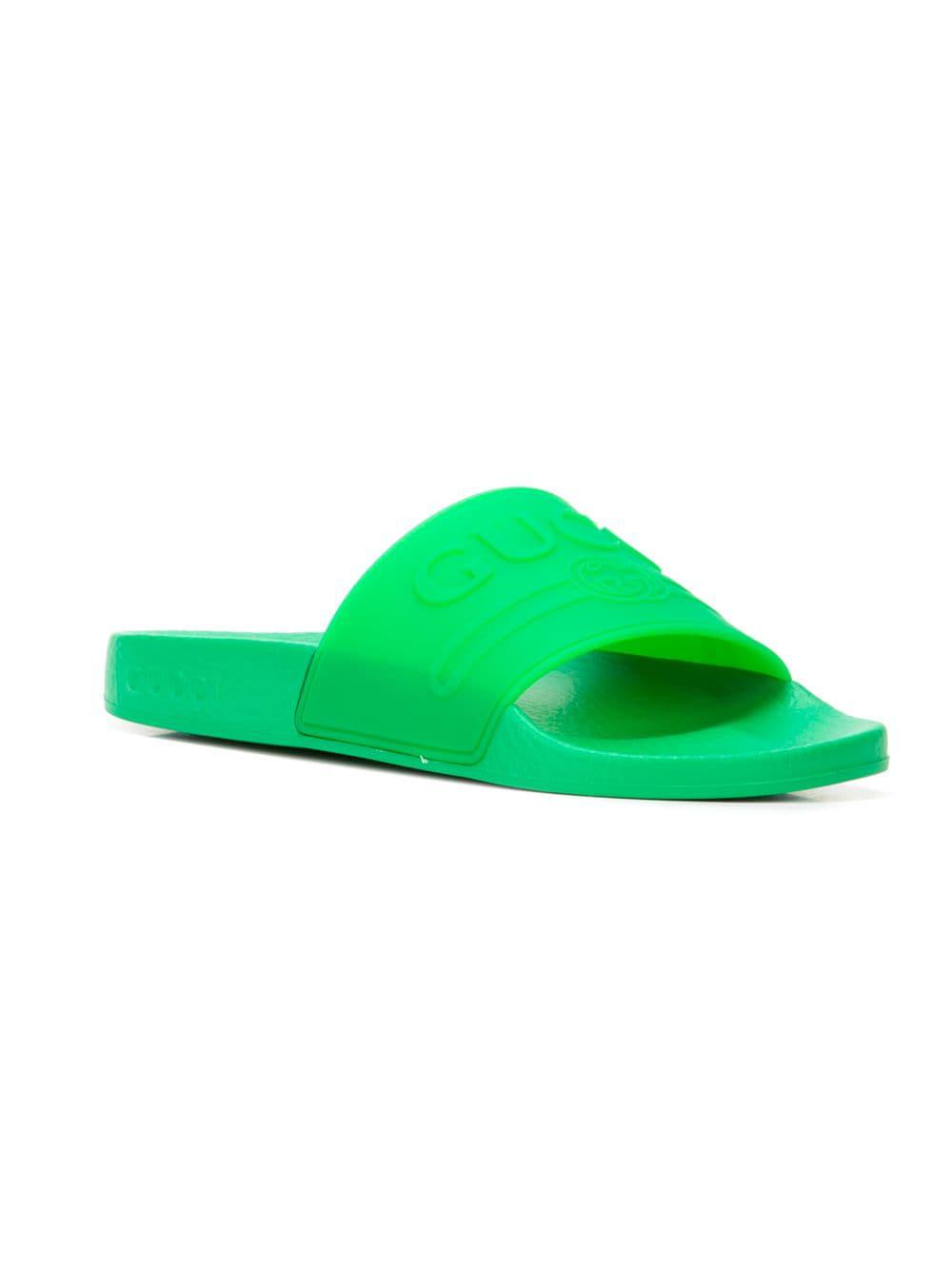 8e07d77bd10 Lyst - Gucci Logo Embossed Slides in Green