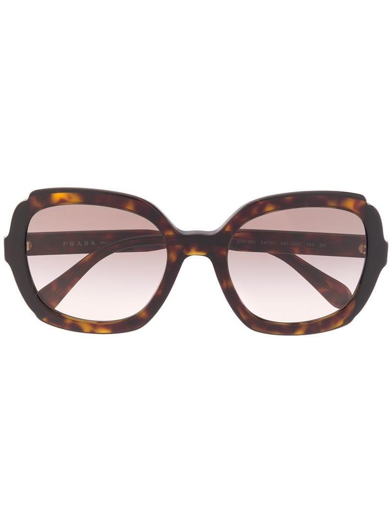 44787a9167e Lyst - Prada Oversized Sunglasses in Brown