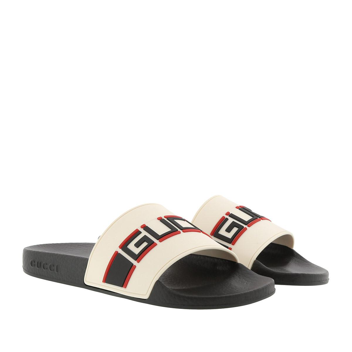 dcd214b06131f2 Gucci Rubber Slides Black white in Black - Save 20% - Lyst