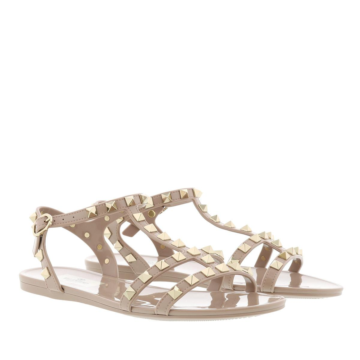 be6411a6d15b75 Valentino Rockstud Flat Sandals Soft Pvc Poudre in Natural - Lyst