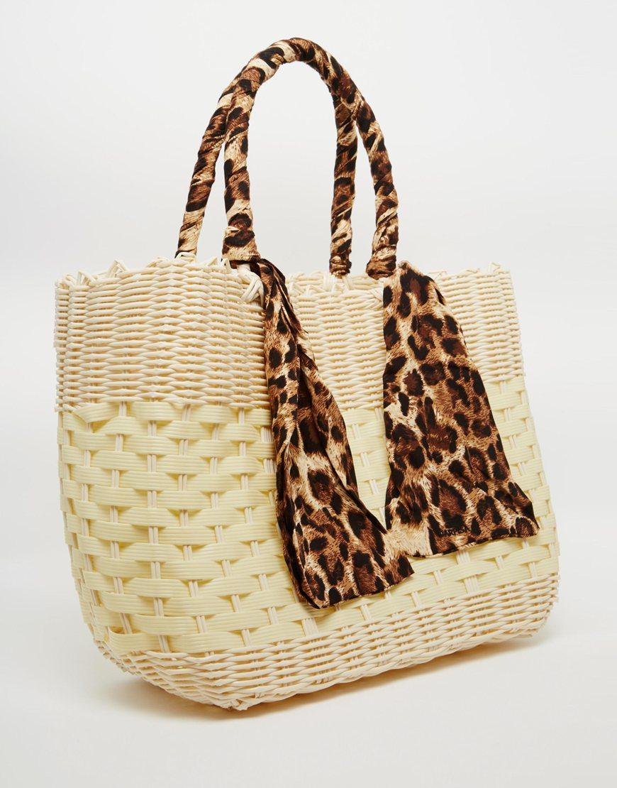 carpisa basket tote bag with leopard print handle lyst