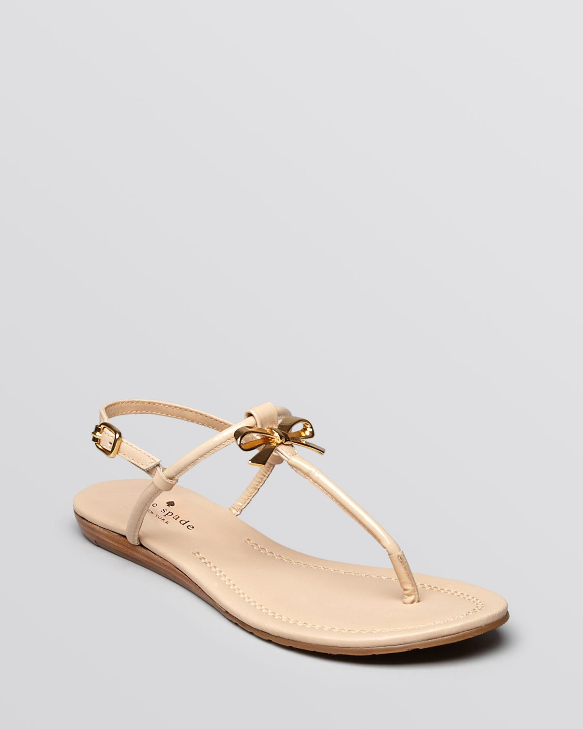 86f78218c4b7 Lyst - Kate Spade Flat Thong Sandals Tracie Bow in Natural