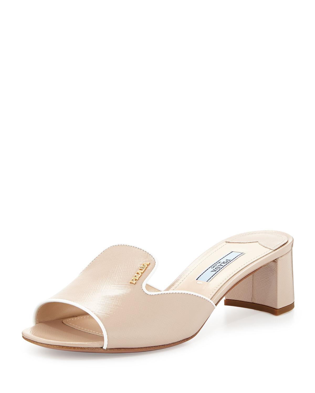4a7175d728f7 Prada Saffiano Slide Sandals in Natural - Lyst